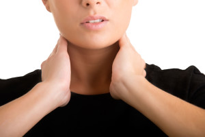 34703326 - woman with a sore throat holding her neck